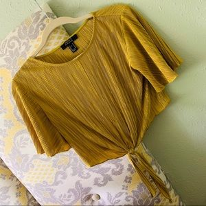 Pleated gold top with knot